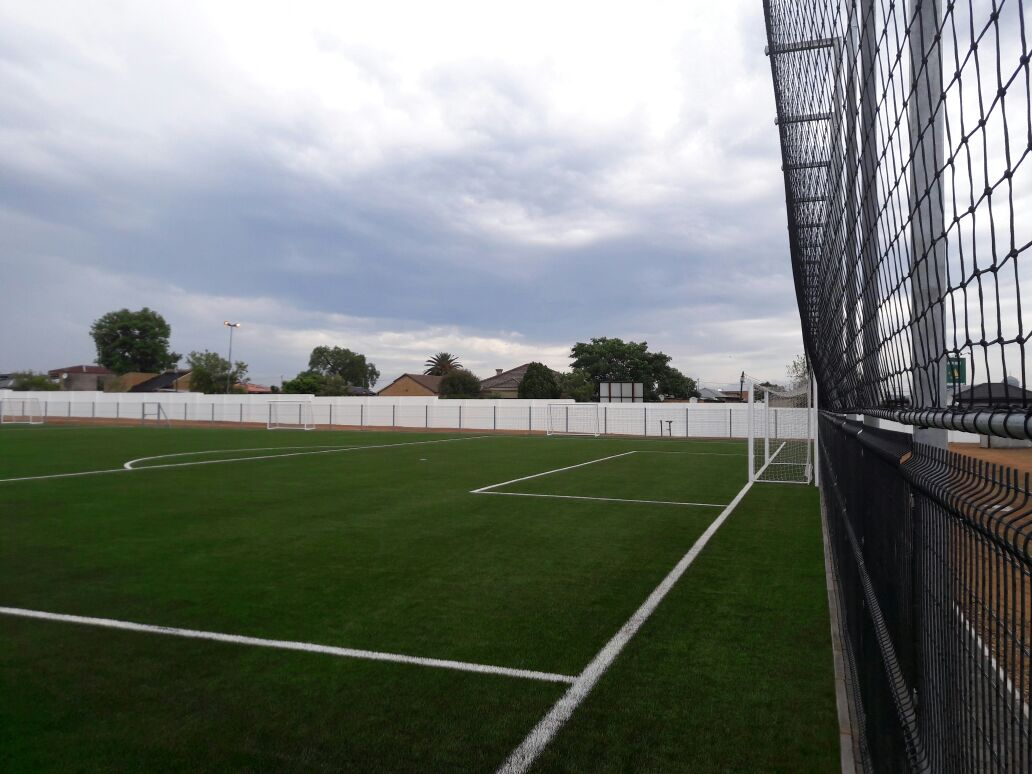 grass soccer field with goal. Fencing Around Community Soccer Field Grass With Goal